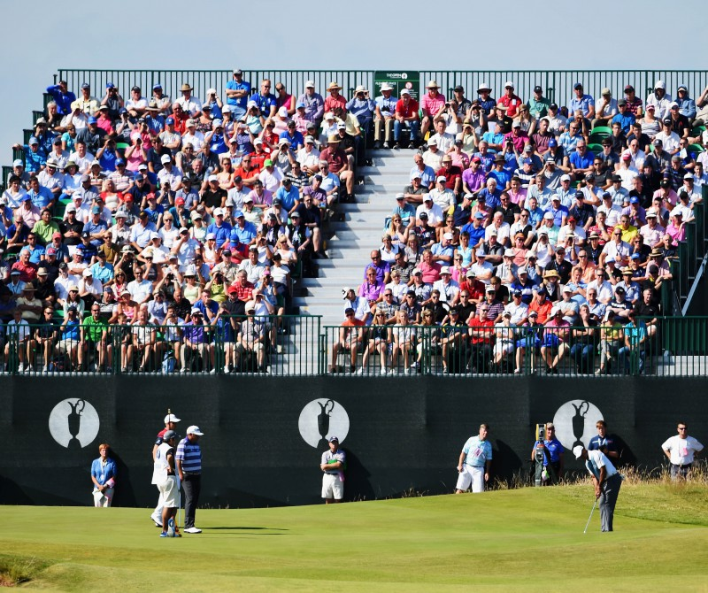 HOYLAKE, ENGLAND - JULY 17:  Tiger Woods of the United States putts in front of a grandstand on the fifth green during the first round of The 143rd Open Championship at Royal Liverpool on July 17, 2014 in Hoylake, England.  (Photo by Ross Kinnaird/R&A/R&A via Getty Images) *** Local Caption *** Tiger Woods