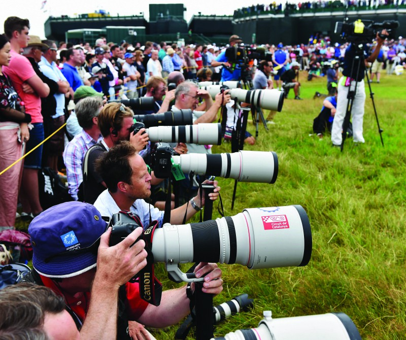 HOYLAKE, ENGLAND - JULY 20:  Photographers follow the action during the final round of The 143rd Open Championship at Royal Liverpool on July 20, 2014 in Hoylake, England.  (Photo by David Cannon/R&A/R&A via Getty Images)